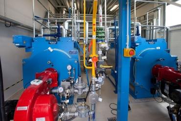 Dujų deginimo katilai. Deginant biodujas, gaminama šilumos energija.